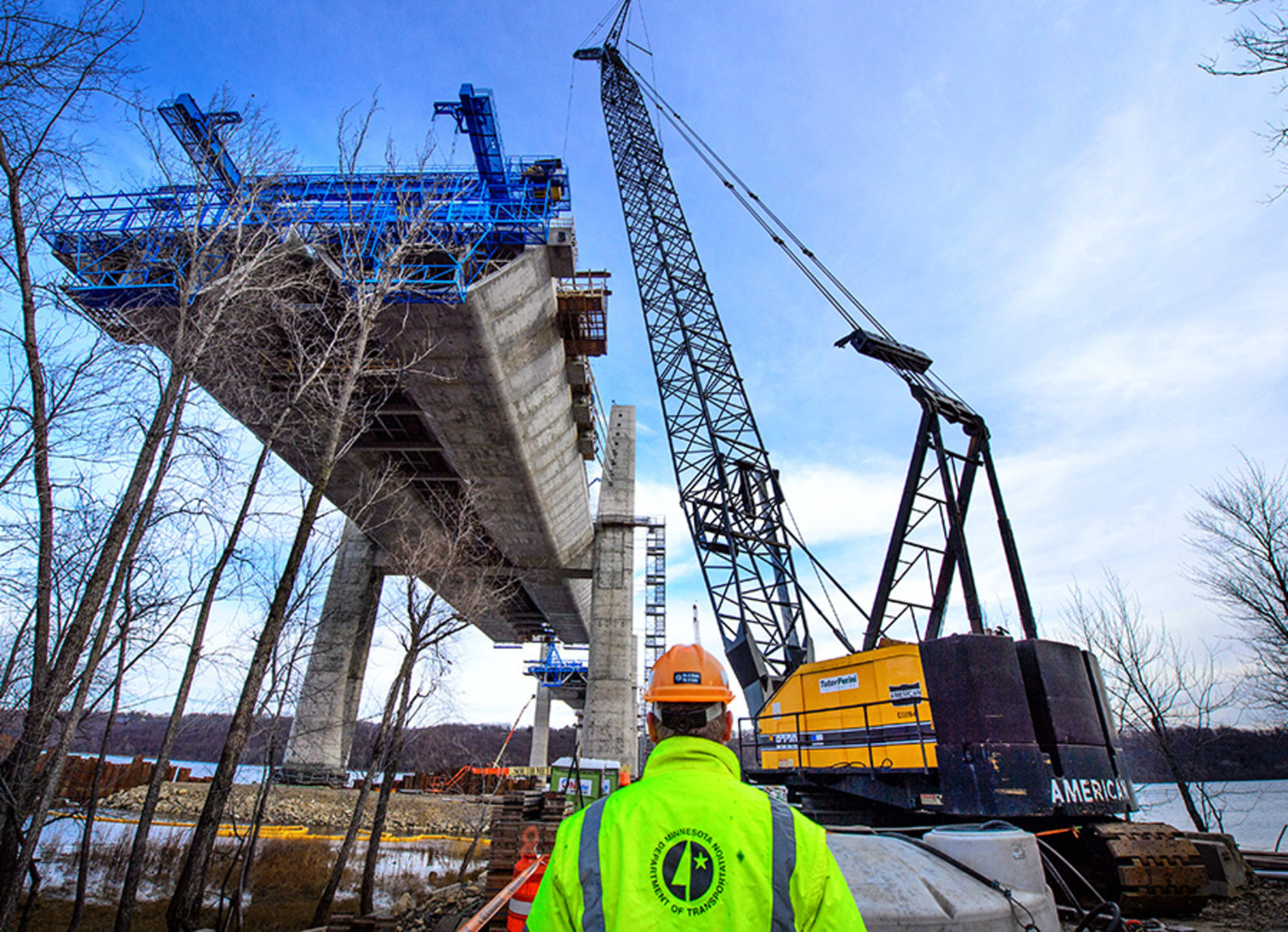 Why is the construction of a bridge across the Volga behind schedule? 11